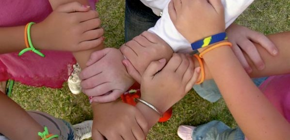 a group of children with their hands connected